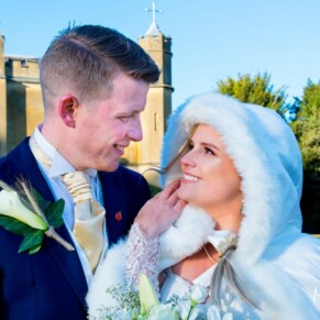 Newlyweds Missenden Abbey autumn wedding pose in the gardens of the abbey
