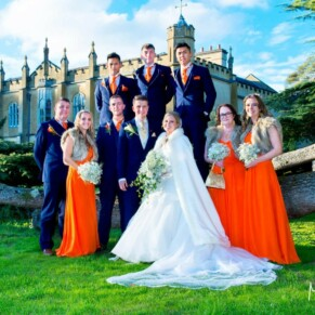 Missenden Abbey autumn wedding pose of the bridal party under the cedar tree