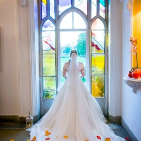 Missenden Abbey autumn wedding shot of the bride in the stained glass window