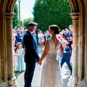 Newlyweds in the doorway at their St Mary's Church Amersham wedding