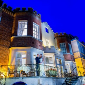 Taplow House summer wedding pose on the terrace at dusk