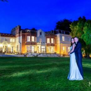 Taplow House newlyweds summer wedding pose at dusk