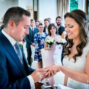 Exchanging rings at Taplow House summer wedding