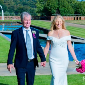 Grove Hotel Watford wedding photography of the bride and groom taking a walk in the gardens