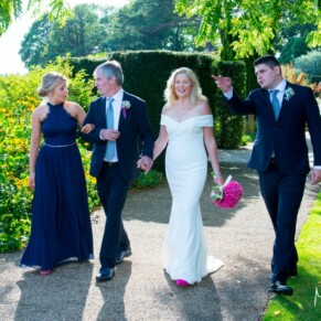 Grove Hotel Watford wedding photography of the newlyweds taking a stroll