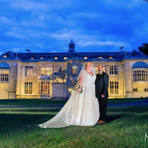 Dusk pose of the newlyweds at their Hartwell House autumn wedding